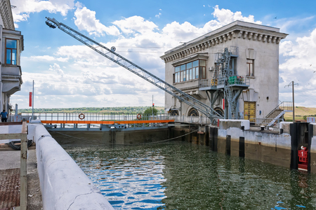 VOLGOGRAD - JUNE 19: A special device resembling a restrictive barrier is lowered to protect the lock gates from colliding with the vehicle during locking. June 19, 2017 in Volgograd, Russia.