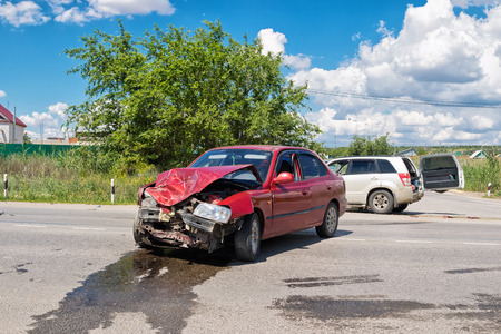 crossover: VOLGOGRAD - JUNE 19: Road accident on a country road between the crossover and the red sedan without casualties. June 19, 2017 in Volgograd, Russia.