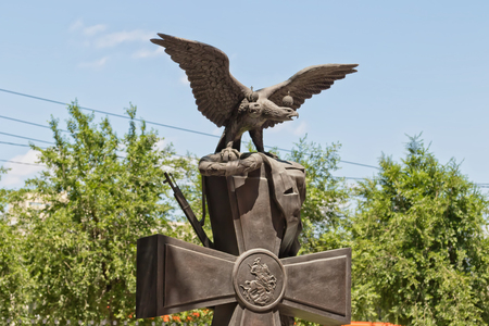 double headed: VOLGOGRAD - JUNE 8: Monument to inhabitants of Tsaritsyn - participants of the first world war. Made in form of a Celtic cross on which sits double-headed eagle. June 8, 2017 in Volgograd, Russia.
