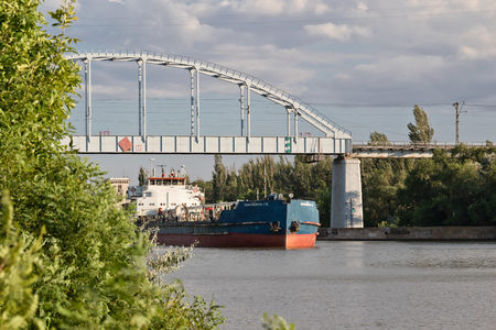VOLGOGRAD - JULY 30: Transportation of goods and petroleum products on barges on the Volga-don shipping canal. July 30, 2016 in Volgograd, Russia.