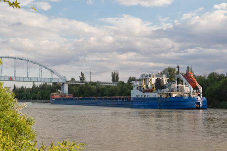 navigable: VOLGOGRAD - MAY 22: Transportation of goods and petroleum products on barges on the Volga-don shipping canal. May 22, 2016 in Volgograd, Russia.
