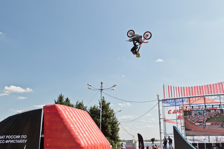 VOLGOGRAD - SEPTEMBER 9: Tricks on a motorcycle jump performed by the athletes during the first championship of Russia on freestyle motocross. September 29 2017 in Volgograd Russia.