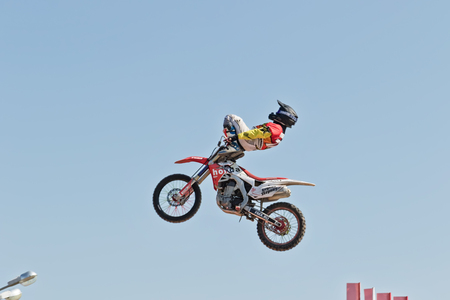 VOLGOGRAD - SEPTEMBER 9: Tricks on a motorcycle jump performed by the athletes during the first championship of Russia on freestyle motocross. September 29 2017 in Volgograd Russia. Redakční