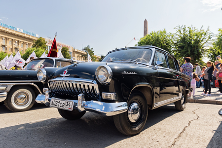 restored: VOLGOGRAD - SEPTEMBER 9: Restored and painted in shiny metallic black Volga GAZ-21 at the exhibition of vintage cars. September 9, 2016 in Volgograd, Russia.