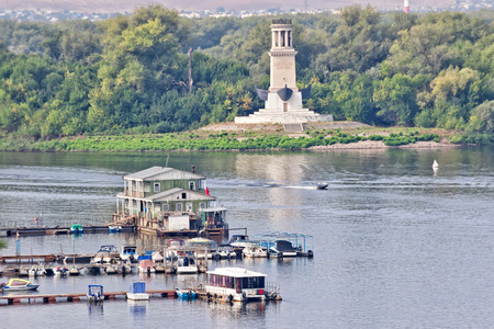 VOLGOGRAD - SEPTEMBER 16: The entrance to the Volga-don canal from the Volga river , with views of the lighthouse and a statue of Lenin. September 16, 2017 in Volgograd, Russia.