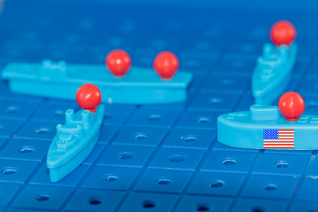 American nuclear submarine with a nuclear missile surrounded by enemies on the Board game battleship Stock Photo