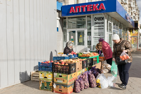 VOLGOGRAD - OCTOBER 31: Selling vegetables and fruit from farms on the patch in the open air on the street. October 31, 2017 in Volgograd, Russia
