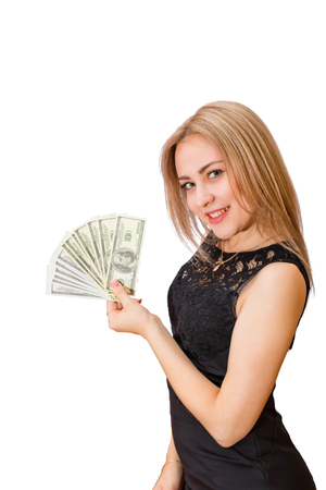 Beautiful young blonde in hand a fan of hundred-dollar bills and smiling looking at the camera. Isolated portrait on white background