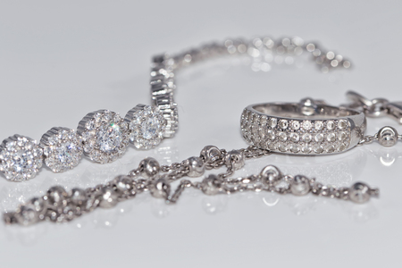 A set of silver jewelry from chains, rings, signet rings and bracelet with gemstones