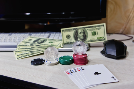 Table player online casino chips, cards, keyboard, mouse, and coins of bitcoin