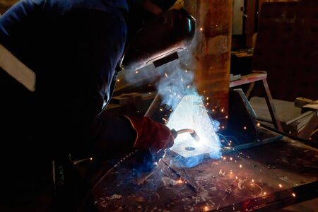 Semi-automatic welding with sparks and smoke closeup