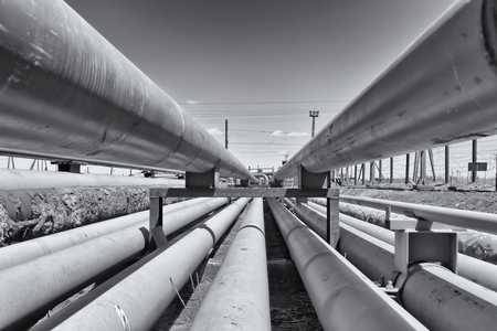 detail of steel light pipeline in oil refinery. Black and white photo