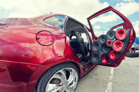 car with a large number of installed audio speakers and subwoofer