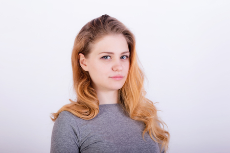 Portrait of a charming young woman with long red hair and blue eyes Stock Photo