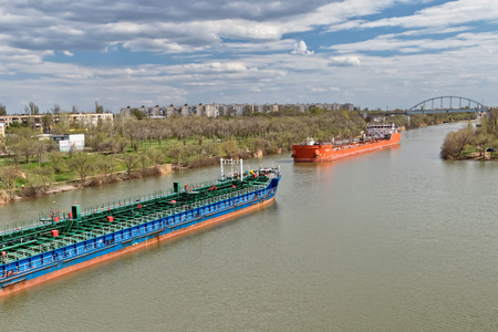 VOLGOGRAD, RUSSIA - APRIL 29: Large river barges for transportation of oil products swim through the navigable Volga-don canal. April 29, 2018  in Volgograd, Russia. Editorial