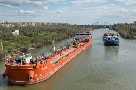 VOLGOGRAD, RUSSIA - APRIL 29: Large river barges for transportation of oil products swim through the navigable Volga-don canal. April 29, 2018 in Volgograd, Russia.