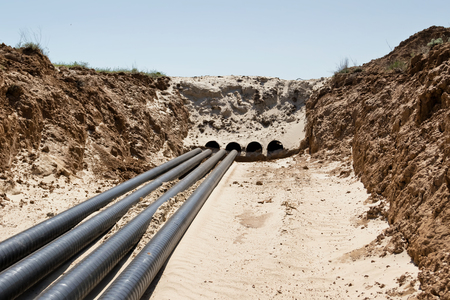 Laying pipelines in a special corrosion-resistant insulation in the trench on the sand
