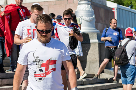 VOLGOGRAD - JUNE 18: Football fans of the national team of England with national flags and attributes in fanzone fanfesta before the match England-England. June 18, 2018 in Volgograd, Russia. Editoriali