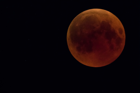 Lunar Eclipse: the phase of the blood moon completely covered by the shadow of the Earth from the sun