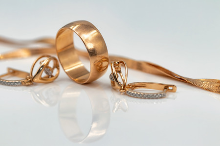 Gold jewelry: earrings with dancing diamonds, gold ring and gold chain