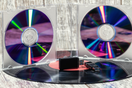 Music media for the last 100 years: vinyl record, laser disc and USB flash drive