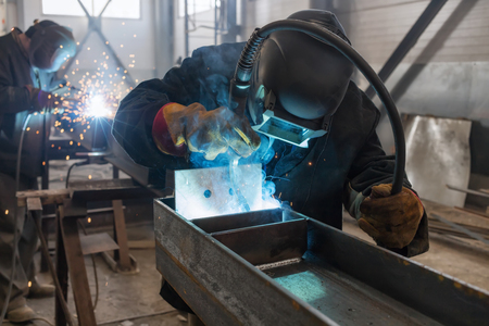 Welder performs welding work of metal structures in a complex spatial position semi-automatic welding