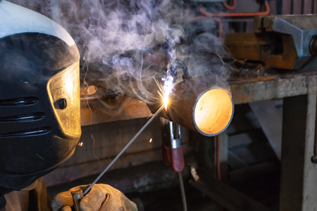 The welder brews a control sample from small diameter pipes to confirm his qualification. The sample is welded in a fixed position