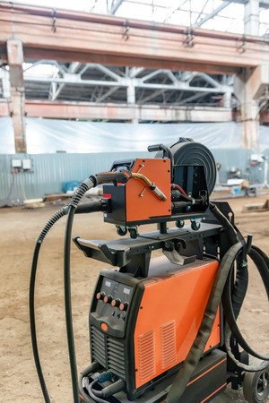 The device for semi-automatic welding in the environment of protective gases is in a spacious shop for the Assembly of metal structures