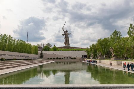 VOLGOGRAD - MAY 4: Monument Motherland on Mamaev Kurgan. The photo is made through a glass ball. May 4, 2019 in Volgograd, Russia. Sajtókép