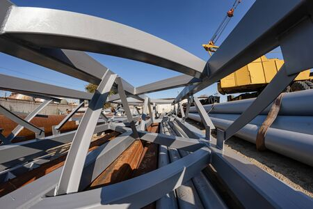 The section of metal structures ready for shipment lies on the production base under the open sky 스톡 콘텐츠
