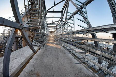 Construction of a new cable overpass made of aluminum profile with a concrete base 版權商用圖片