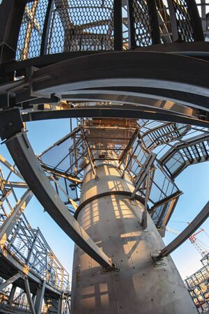 The view from the bottom on the maintenance platforms at the top of the column for hydrocracking in an oil refinery