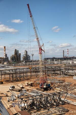 Construction site of an oil refinery with a large number of preformed pipeline par