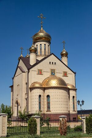 Christian Church of light brick with Golden domes and crosses