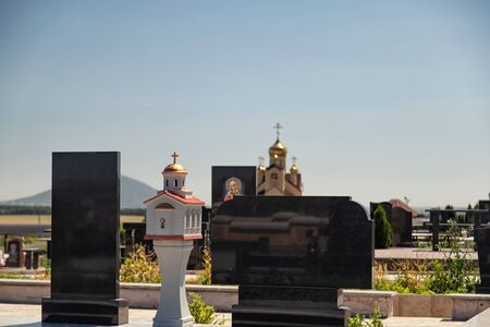 Marble monuments and decorative architectural elements at the cemetery in the Cossack village in the Caucasus