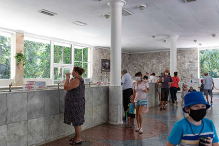 ESSENTUKI- AUGUST 19: Tourists of the Spa town visit the gallery of drinking mineral water in protective masks. August 19, 2020 in Essentuki, Russia. Stok Fotoğraf - 154118689