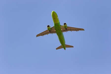 MINERALNYE VODY - SEPTEMBER 05: Airbus A320 of S7 airlines with tail number VQ-BRD flies over the observer. View from the ground to the plane. September 05, 2020 in Mineralnye Vody, Russia.