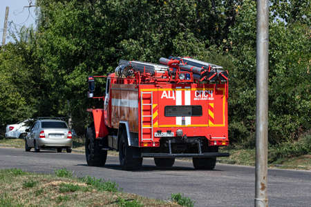 MINERALNYE VODY - SEPTEMBER 05: A large red fire truck on the Ural 4320 chassis is driving along the road to an emergency call. September 05, 2020 in Mineralnye Vody, Russia.