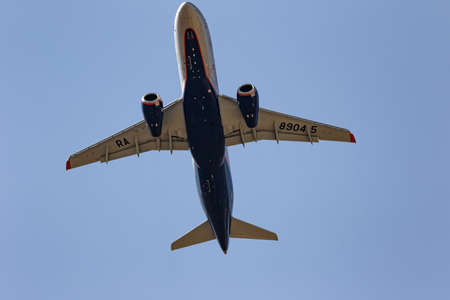 MINERALNYE VODY - SEPTEMBER 05: Take-off of the Sukhoi superjet 100-95B flight number RA-89045 of Aeroflot. View from the ground. September 05, 2020 in Mineralnye Vody, Russia. Stok Fotoğraf - 155244926