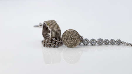 Silver women's jewelry with diamonds: rings and bracelet Stok Fotoğraf
