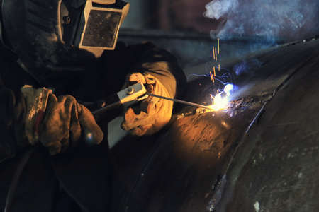 The process of electric arc welding of technological equipment made of carbon steel close-up