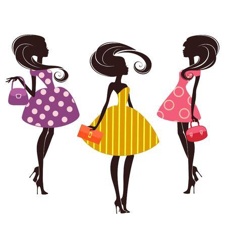 Tres chicas de moda en el fondo blanco