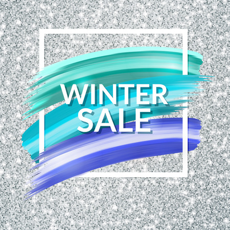 Winter sale paint banner on silver glitter background.