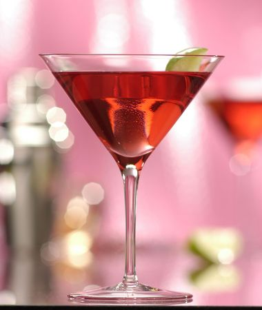 stirred: martini made with white zinfandel,cranberry juice,over ice in a shaker, add a splash of Chambord garnish with lime