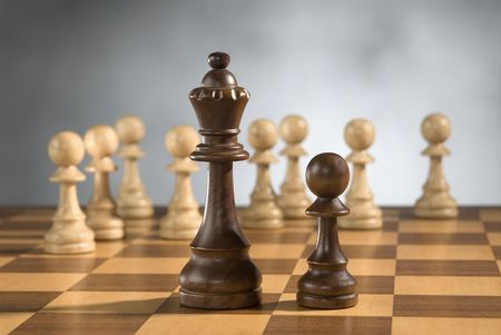 beautiful wooden chess pieces on wooden chess game board Stock Photo