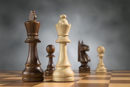 beautiful wooden chess pieces on wooden chess game board photo