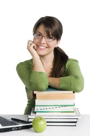 profesores: como mujer joven en busca de un estudiante  profesor, con el port�til, la pila de libros, manzana verde Foto de archivo