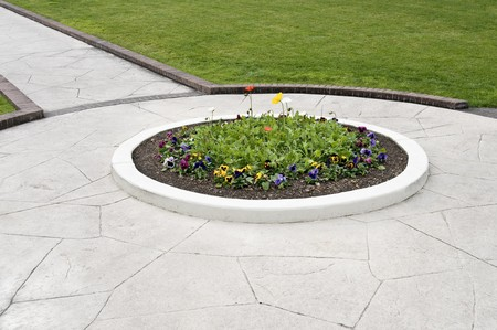 landscaping, showing walkway, flower bed and green lawn Stock Photo