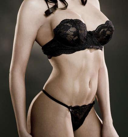 sexy female body wearing black lingerie