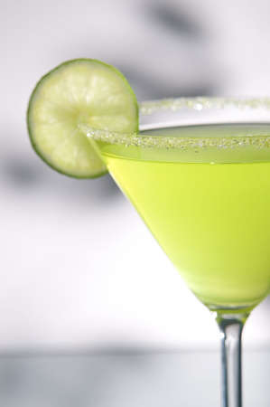 margarita drink with lime, focus is on rim of glass, and salt Stock Photo